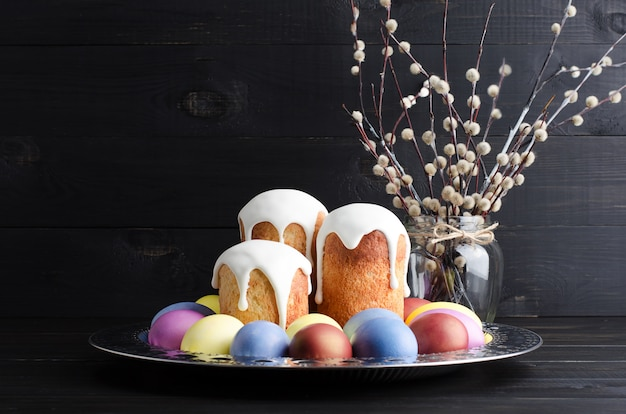 Easter cakes and eggs on a dark, rustic, wooden background