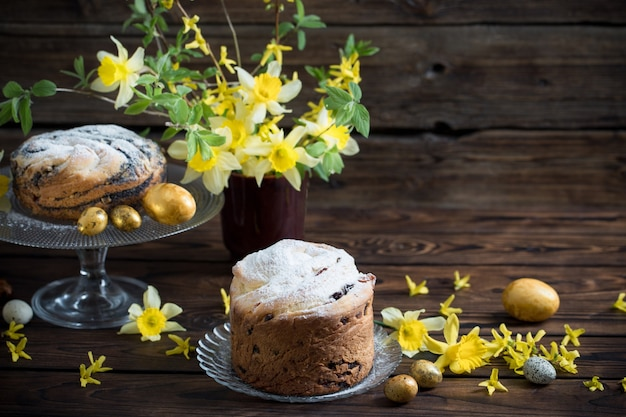Easter cakes and eggs on dark wooden background