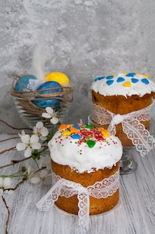 Easter cakes with colored powder in the shape of hearts and colored eggs