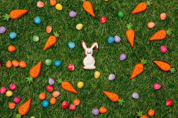 Easter candies and cookies on green grass