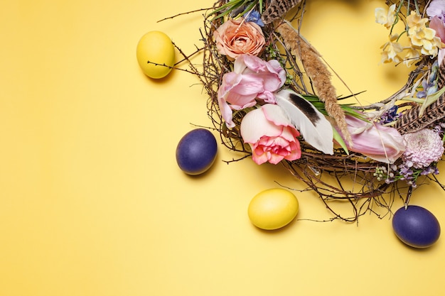 Easter card. painted easter eggs in nest on yellow