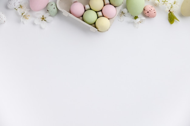 Easter composition on white backgrount, top view