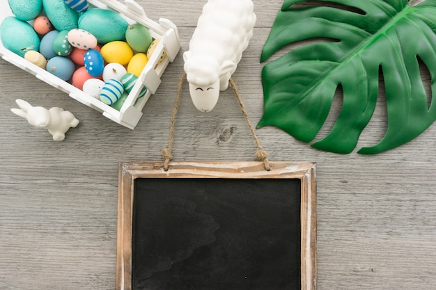 Easter composition with blank slate and other objects