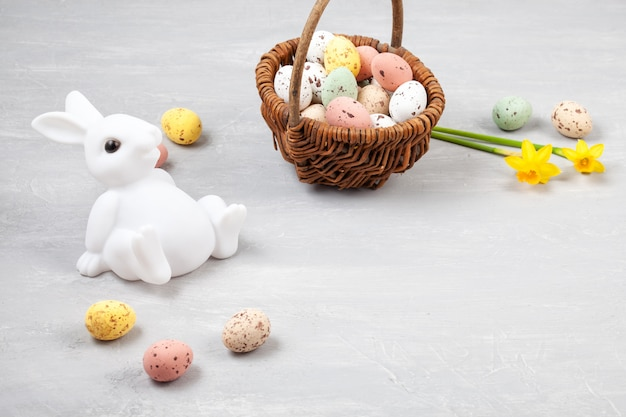 Easter composition with bunnies and eggs