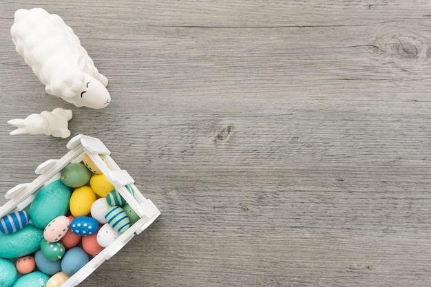 Easter composition with colored eggs, rabbit and sheep
