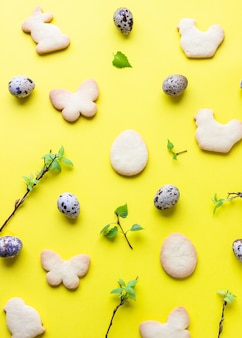 Easter composition with cookies, quail eggs and birch tree branches
