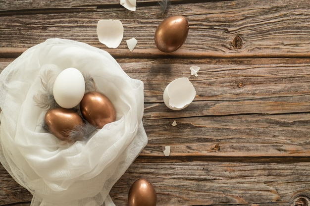 Easter composition on a wood background. egg shell. easter concept.