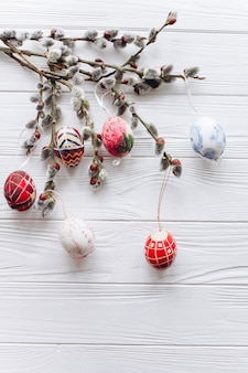 Easter concept branches twigs  and eggs on a wooden background
