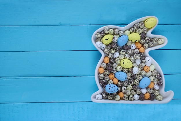 Easter concept.easter bunny decorative with easter eggs on a wooden board background.