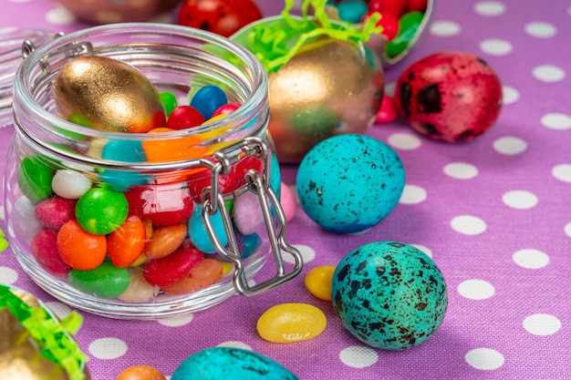 Easter concept.  eggs and colored sweets on table close up