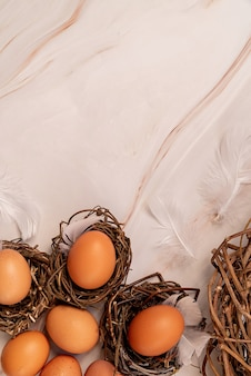 Easter concept. nests with brown eggs top view flat lay on marble background