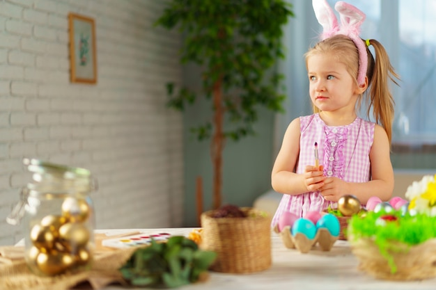 Easter concept. toddler blonde happy  girl with bunny ears