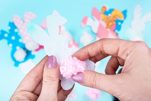 Easter craft of making yarn pom pom bunny tail with a fork. easter content