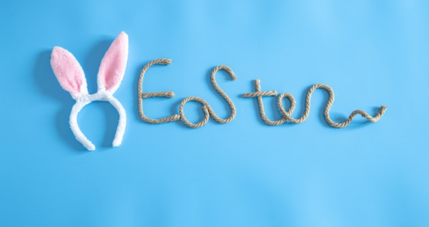 Easter creative inscription on blue with items of easter decor.