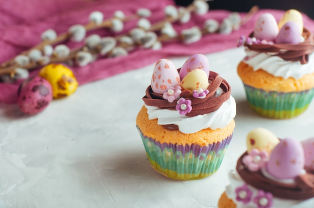 Easter cupcakes decorated with candy eggs in nest