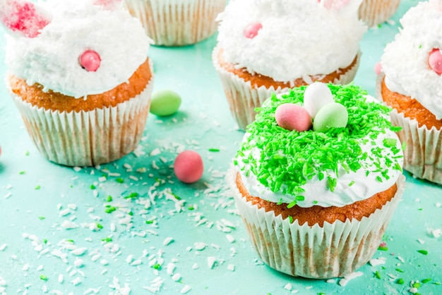 Easter cupcakes with bunny ears and candy eggs,