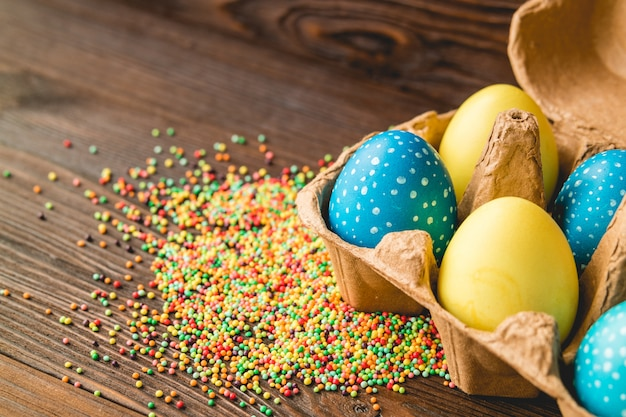 Easter decoration of colored eggs on a wooden table
