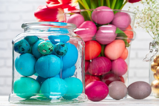 Easter decoration. flower bouquet with colored eggs