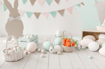 Easter decoration of the room, studio. Big wall with garland on background.