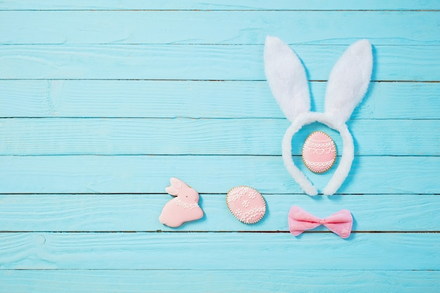 Easter decorations on blue wooden background