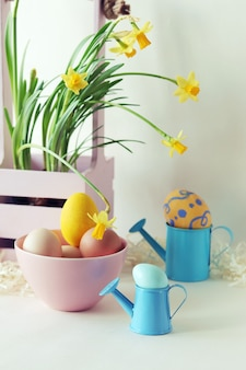 Easter decorations, eggs and a bouquet of spring yellow flowers