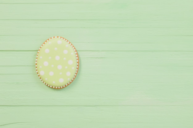 Easter decorations on green wooden background