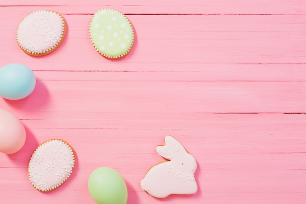 Easter decorations on pink wooden background