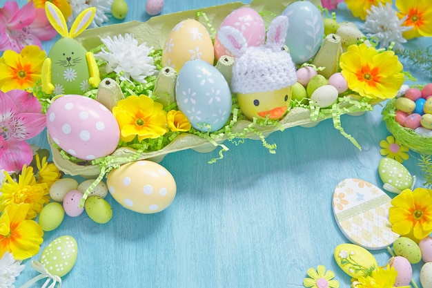 Easter decorations with colorful eggs, candies and flowers