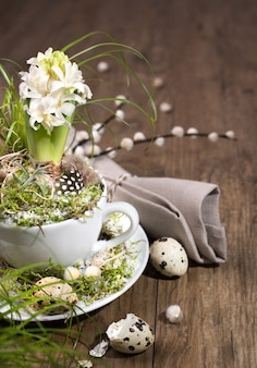 Easter decorations with white pearl hyacinth on wood