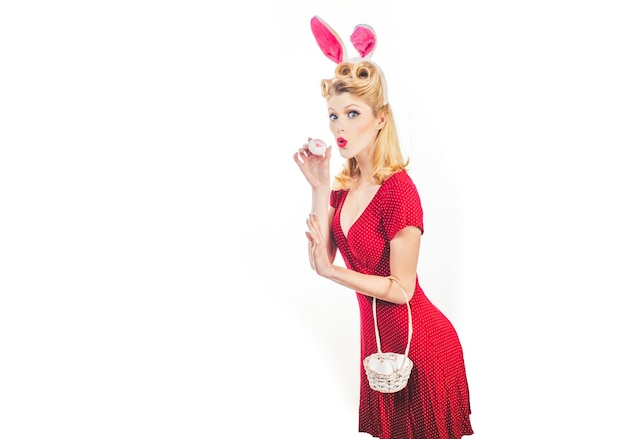 Easter egg hunting. woman wearing a mask easter bunny and looks very sensually. happy easter