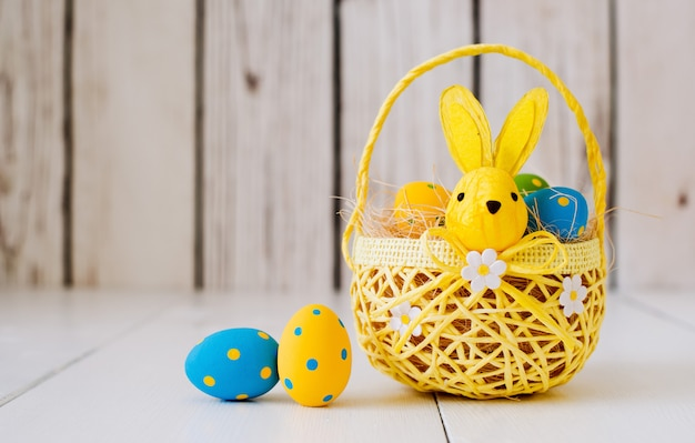 Easter eggs in a basket background,