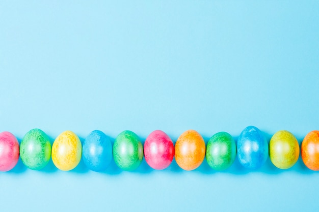 Easter eggs on a blue background. easter celebration concept. flat lay, top view