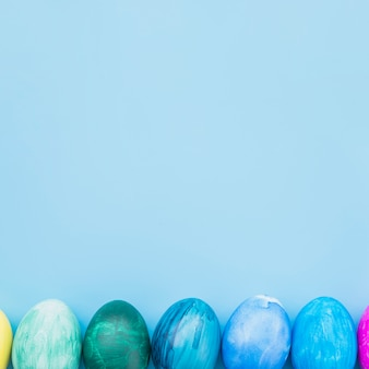 Easter eggs on blue background