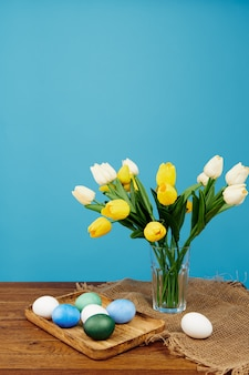 Easter eggs bouquet flowers decoration holiday blue background
