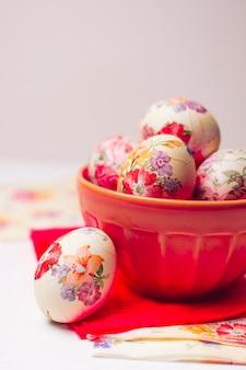 Easter eggs in bowl near napkins
