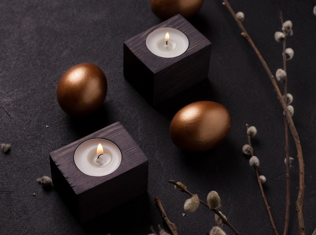 Easter eggs next to candles