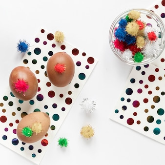 Easter eggs and colored dots on paper