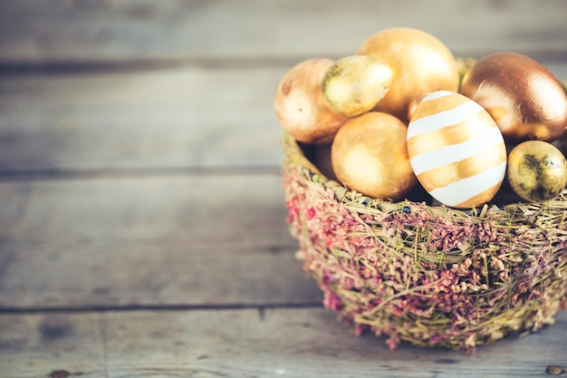 Easter eggs colored with golden paint in differen patterns. copy space.