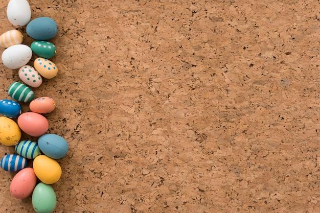 Easter eggs on cork background