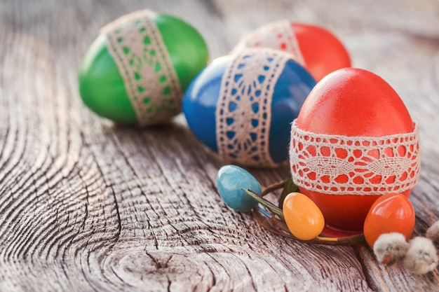 Easter eggs decorated with lace on wooden table. selective focus