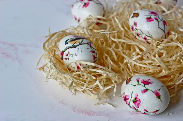 Easter eggs in a decorative nest on a marble background