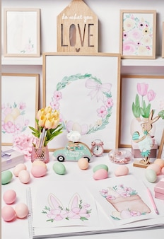Easter eggs and flowers. spring greeting card happy easter. easter decor. watercolor spring paintings. designer and artist's workplace. creative space.
