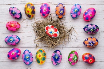 Easter eggs frame with colorful egg in the middle