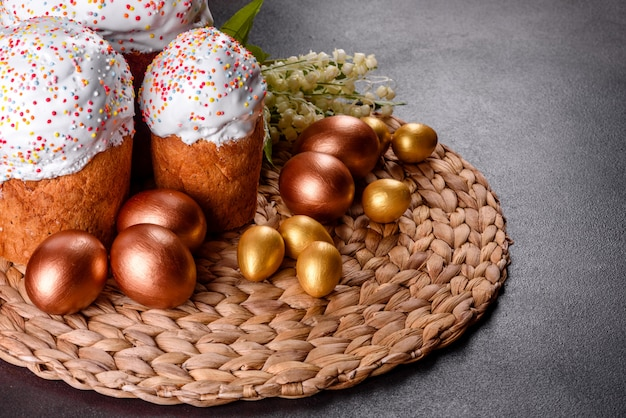 Easter eggs gold and bronze and easter cake.