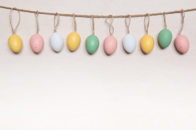 Easter eggs hanging on rope