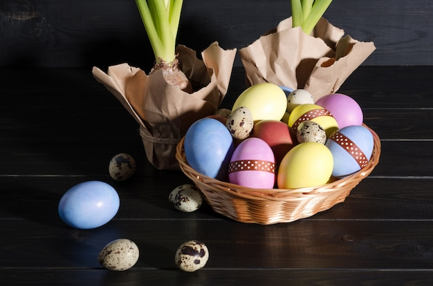 Easter eggs and hyacinths on a dark background