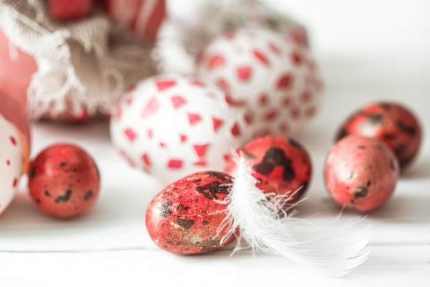 Easter eggs on a light wooden table