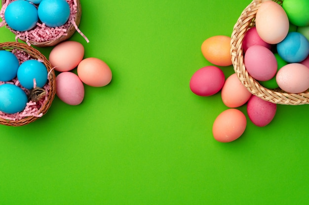 Easter eggs in a nest on green background