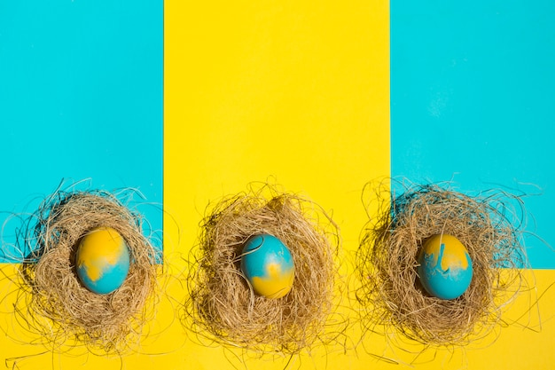 Easter eggs in nests on table
