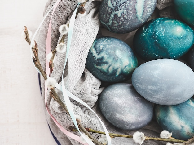 Easter eggs painted in bright colors on a white background